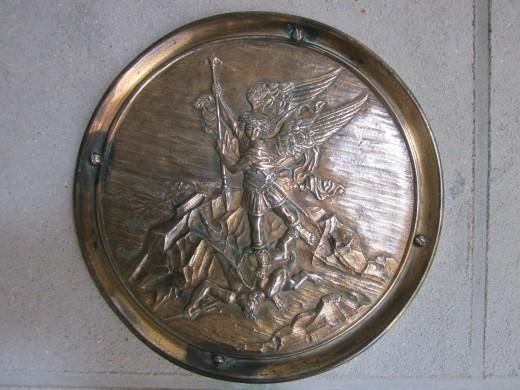 Plaque, Archangel Michael vanquishing the devil, Stoke St Michael Church